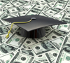 picture of graduation cap on a pile of money