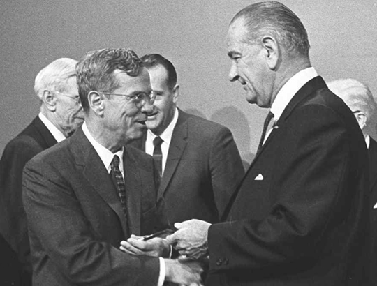 President Johnson (right) shakes hands with William McChesney Martin (left), chairman of the Federal Reserve Board