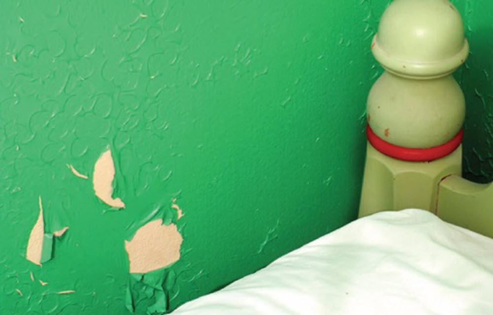 Bedroom with peeling lead paint
