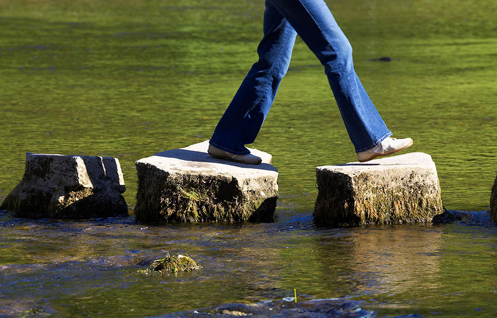 walking on stepping stones across water