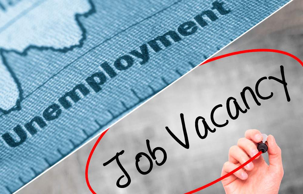 "diagonally split image of an unemployment chart and the words ""Job Vacancy"" circled"